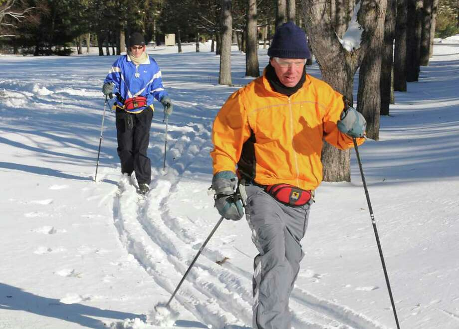 If you own skis, the storm brought just what you?ve been waiting for. Christine Norris and her boyfriend, Bill Armstrong, both of Connecticut, cross-country ski on a golf course Monday at Saratoga Spa State Park in Saratoga Springs.  (Lori Van Buren / Times Union) Photo: Lori Van Buren