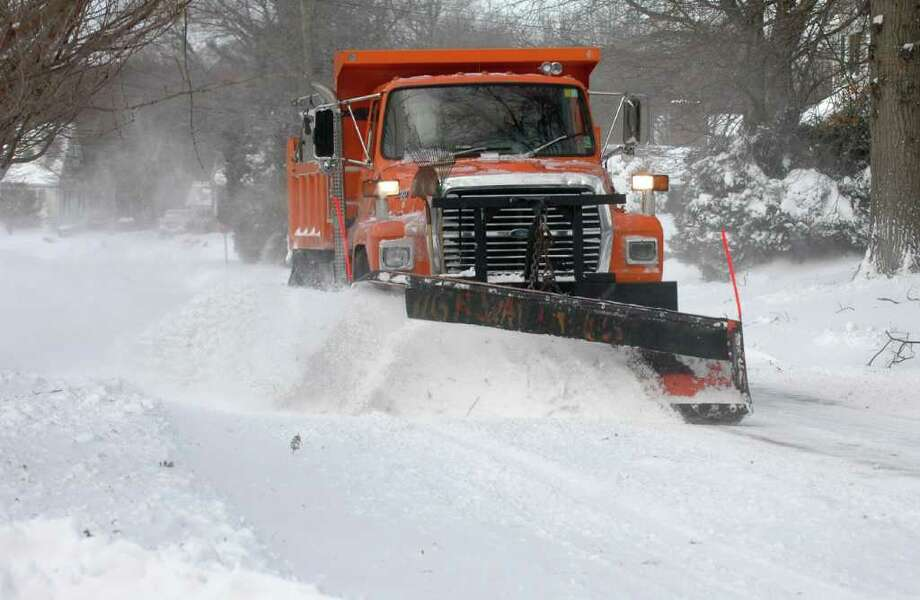 A plow makes another run down Judd Street in Fairfield, Conn. on Monday, December 27, 2010. Photo: Cathy Zuraw / Connecticut Post