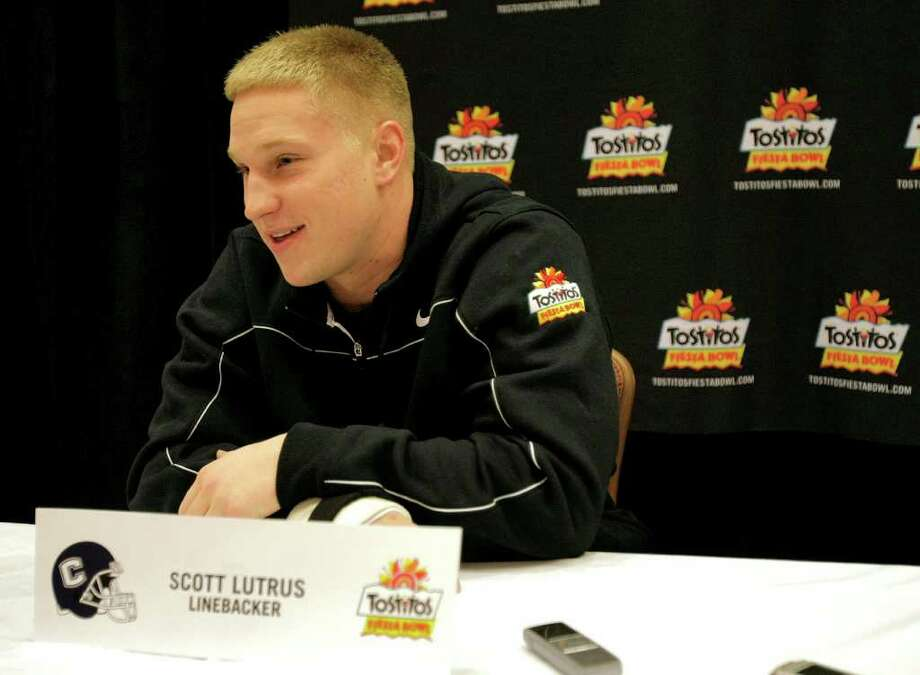 Connecticut linebacker Scott Lutrus speaks with the media Monday, Dec. 27, 2010 at the team hotel in Scottsdale, Ariz. Connecticut will face Oklahoma in the Fiesta Bowl on Jan 1, 2011. (AP Photo/Matt York) Photo: AP