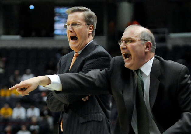 Siena coach Fran McCaffery, left, and assistant coach Mitch Buonaguro, right, protest a call during their basketball game against Loyola during the MAAC Tournament on March 9, 2008, at the Times Union Center in Albany. (Cindy Schultz/Times Union archive)