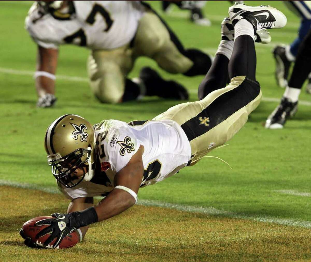 MIAMI GARDENS, FL - FEBRUARY 07: Pierre Thomas #23 of the New Orleans Saints leaps into the end zone to score a touchdown against of the Indianapolis Colts in the third quarter during Super Bowl XLIV on February 7, 2010 at Sun Life Stadium in Miami Gardens, Florida. (Photo by Elsa/Getty Images) *** Local Caption *** Pierre Thomas