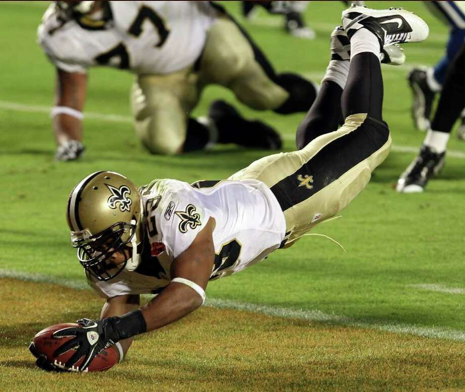 MIAMI GARDENS, FL - FEBRUARY 07:  Pierre Thomas #23 of the New Orleans Saints leaps into the end zone to score a touchdown against of the Indianapolis Colts in the third quarter during Super Bowl XLIV on February 7, 2010 at Sun Life Stadium in Miami Gardens, Florida.  (Photo by Elsa/Getty Images) *** Local Caption *** Pierre Thomas Photo: Getty Images