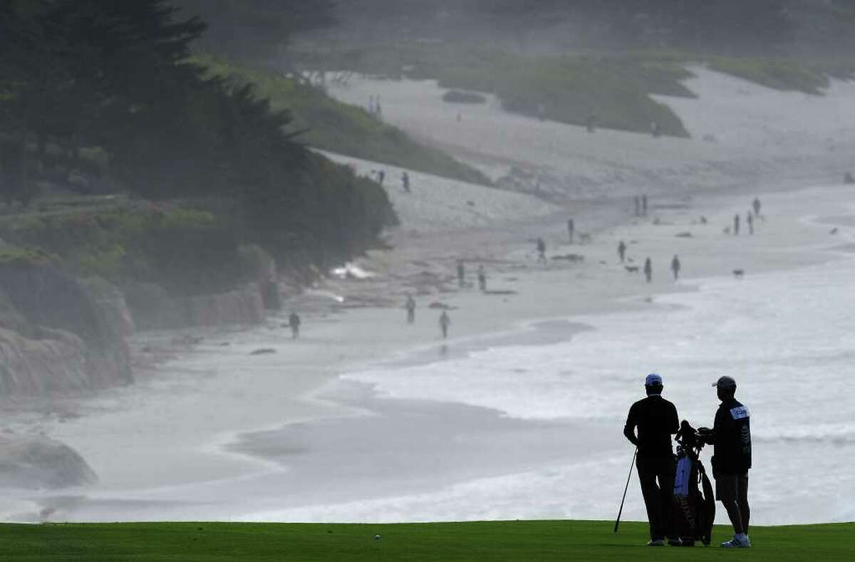 PEBBLE BEACH, CA - FEBRUARY 12: Tim Clarke of South Africa and caddie on the nineth hole during round two of the AT&T Pebble Beach National Pro-Am at Pebble Beach Golf Links on February 12, 2010 in Pebble Beach, California. (Photo by Stuart Franklin/Getty Images) *** Local Caption *** Tim Clarke