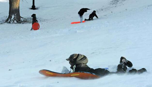 Children brave the freezing temperatures to go sledding in Lincoln Park in Albany, NY on December 27, 2010. (Lori Van Buren / Times Union) Photo: Lori Van Buren