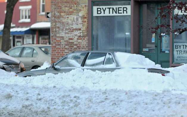 A car is plowed in after a snowstorm in Albany, NY on December 27, 2010. (Lori Van Buren / Times Union) Photo: Lori Van Buren