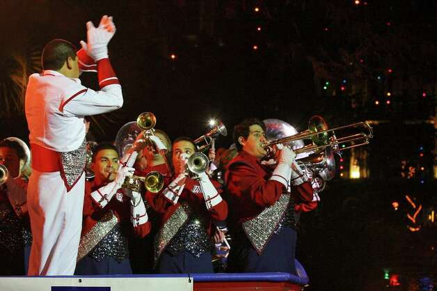 "Members of the Arizona Wildcats band play during ""The Original"" Rudy's Bar-B-Q Pep Rally for the Valero Alamo Bowl held Monday, Dec. 27, 2010, at the Arneson River Theater. Photo: EDWARD A. ORNELAS, SAN ANTONIO EXPRESS-NEWS / eaornelas@express-news.net"