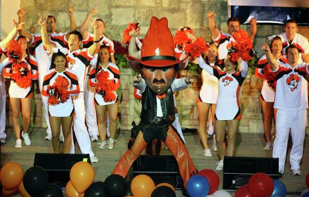 "Oklahoma State's Pistol Pete performs with cheerleaders during ""The Original"" Rudy's Bar-B-Q Pep Rally for the Valero Alamo Bowl held Monday, Dec. 27, 2010, at the Arneson River Theater. Photo: EDWARD A. ORNELAS, SAN ANTONIO EXPRESS-NEWS / eaornelas@express-news.net"