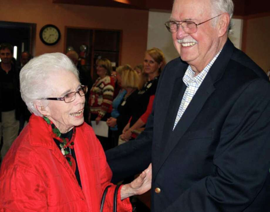 Lucille Rochs, here with Jerry Durr, administrator emeritus of Hill Country Memorial Hospital, has seen plenty of changes in her lifetime. Photo: Gary Scharrer/Express-News
