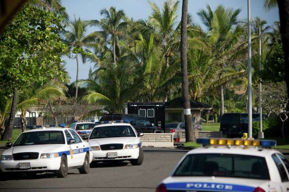 KAILUA, HI - DECEMBER 23: (AFP OUT)  Honolulu Police Department vehicles stand by on the street as U.S. President Barack Obama's motorcade heads towards his vacation compound after leaving Marine Corps Base Hawaii on December 23, 2010 in Kailua, Hawaii.  Obama arrived on December 22 in his native Hawaii for a low-key vacation with his family through the winter holidays. (Photo by Kent Nishimura/Getty Images) Photo: Kent Nishimura, Getty Images / 2010 Getty Images