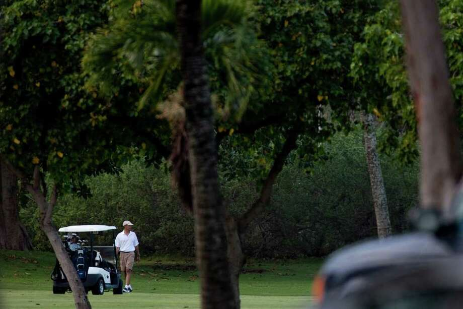 KANEOHE,  HAWAII - DECEMBER 23:   U.S. President Barack Obama plays a round of golf with friends Bobby Titcomb, Mike Ramos, and Eric Whitaker at the Kaneohe Klipper Golf Course at Marine Corps Base Hawaii on December 23, 2010 in Kaneohe, Hawaii.  Obama arrived on December 22 in his native Hawaii for a low-key vacation with his family through the winter holidays. (Photo by Kent Nishimura/Getty Images) Photo: Kent Nishimura, Getty Images / 2010 Getty Images