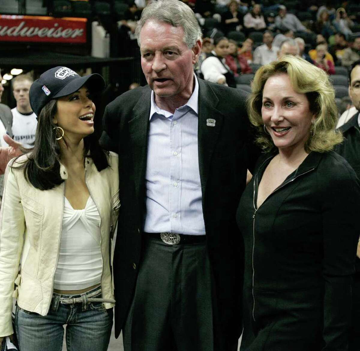 San Antonio Spurs Chairman and CEO Peter Holt and his wife, Julianna (right), talks with actress Eva Longoria at the AT&T Center on Nov. 24, 2004.