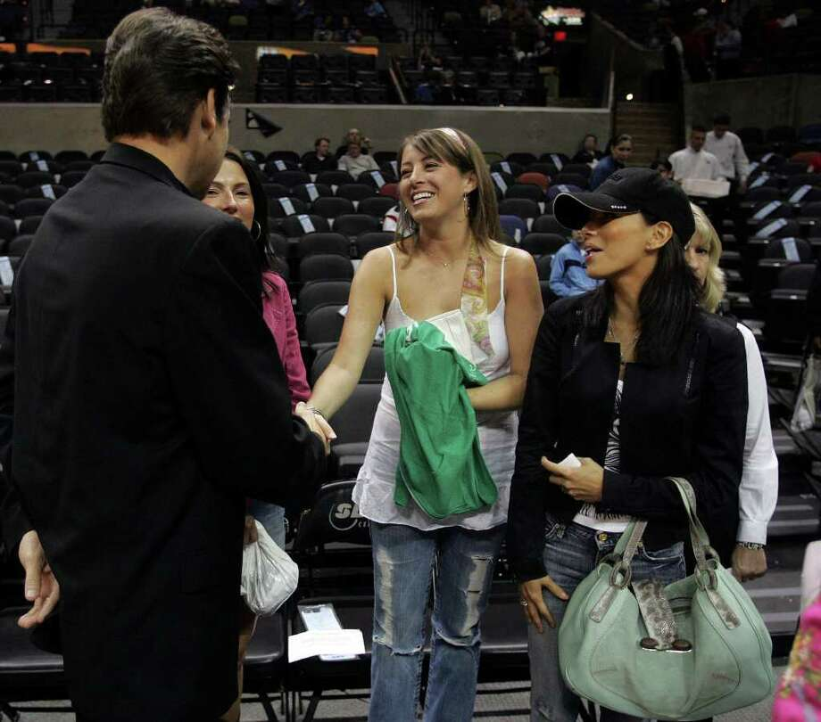 SPORTS - Gov. Rick Perry greets a companion of Eva Longoria (far right) before the start of the Spurs playoff game with the Denver Nuggets Wednesday night May 4, 2005 at the SBC Center for the fifth game of their first-round playoff series. Photo: WILLIAM LUTHER, SAN ANTONIO EXPRESS-NEWS / SAN ANTONIO EXPRESS-NEWS
