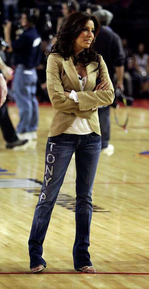 "METRO - Actress Eva Longoria oversees her team warm-ups prior to the McDonald's NBA All-Star Celebrity game presented by 2K Sports at the George R. Brown Convention Center in Houston on Friday, Feb. 17, 2006. Longoria took on the role of a coach for the ""H-Town"" team that included celebrities such as hip hop artist Nelly. Longoria sported denim jeans with the words, ""Tony P"", that likely showed her support for boyfriend and Spurs guard Tony Parker who will be playing as an All-Star for the first time in his NBA career. Photo: KIN MAN HUI, SAN ANTONIO EXPRESS-NEWS / SAN ANTONIO EXPRESS-NEWS"