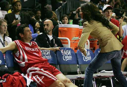 "CONX - Actor Carlos Bernard (left) jokes around with his ""coach"" and fellow actor Eva Longoria prior to the start of the McDonald's NBA All-Star Celebrity game presented by 2K Sports at the George R. Brown Convention Center in Houston on Friday, Feb. 17, 2006. Bernard is known for his role in the Fox Television show, ""24"". Photo: KIN MAN HUI, SAN ANTONIO EXPRESS-NEWS / SAN ANTONIO EXPRESS-NEWS"