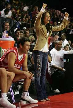 "CONX - Actor Carlos Bernard (left) and his ""coach"" and fellow actor Eva Longoria cheer on teammates during the McDonald's NBA All-Star Celebrity game presented by 2K Sports at the George R. Brown Convention Center in Houston on Friday, Feb. 17, 2006. Bernard is known for his role in the Fox Television show, ""24"". Photo: KIN MAN HUI, SAN ANTONIO EXPRESS-NEWS / SAN ANTONIO EXPRESS-NEWS"