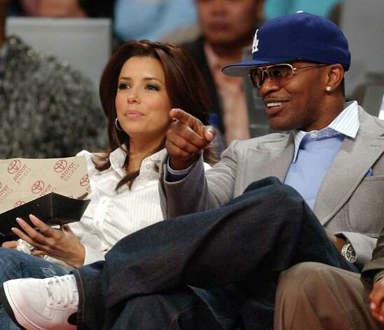 FOR SPORTS - ***CHECK SPELLING ON NAMES**** Eva Longoria and Jamie Foxx watch action during the NBA All-Star game Sunday Feb. 19, 2006 in Houston, TX. PHOTO BY EDWARD A. ORNELAS/STAFF Photo: EDWARD A. ORNELAS, SAN ANTONIO EXPRESS-NEWS / SAN ANTONIO EXPRESS-NEWS