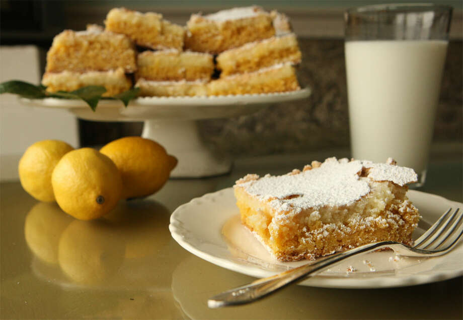 Lemon bars from W.D. Deli include cream cheese and powdered sugar, along with lemon extract to give them their delicious flavor. HELEN L. MONTOYA/hmontoya@express-news.net