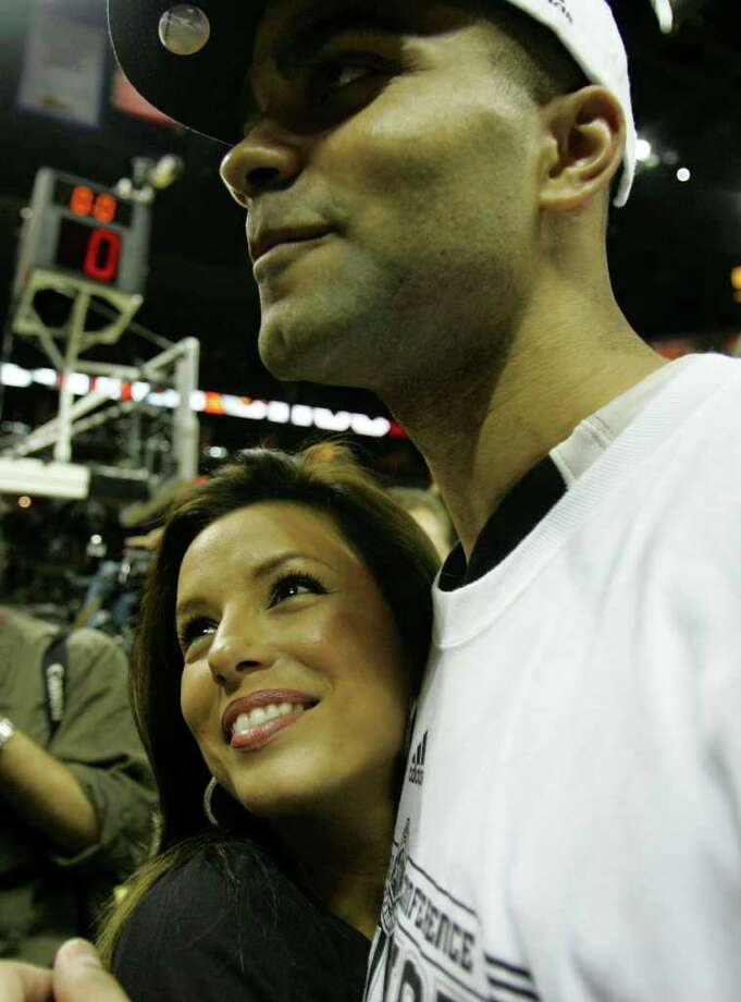 Spurs' guard Tony Parker, of France, (09) and fiance Eva Longoria celebrate the Spurs Western Conference championship during post game festivities  in the Western Conference Finals game five in San Antonio Wednesday May 30, 2007. Photo: JERRY LARA, SAN ANTONIO EXPRESS-NEWS / SAN ANTONIO EXPRESS-NEWS
