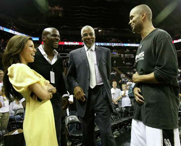 "Spurs' Tony Parker, right enjoys a laugh with NBA Legend, Julius ""Dr. J"" Erving, second from right and Parker's fiancee Eva Longoria prior to the NBA Finals game one in San Antonio Thursday June 7, 2007. Other man is not identified. Photo: TOM REEL, SAN ANTONIO EXPRESS-NEWS / SAN ANTONIO EXPRESS-NEWS"