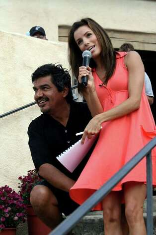METRO- Comedian and actor George Lopez jokes around as he holds down Eva Longoria's dress as it blows in the wind during a brief press conference at La Cantera Palmer Golf Course during Eva's Hero's Celebrity Golf Tournament Saturday Oct.13, 2007. DELCIA LOPEZ/STAFF Photo: DELCIA LOPEZ, SAN ANTONIO EXPRESS NEWS / SAN ANTONIO EXPRESS NEWS