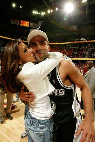 CLEVELAND - JUNE 14:  Actress Eva Longoria and her financee Finals MVP Tony Parker #9 of the San Antonio Spurs after their 83-82 win against the Cleveland Cavaliers in Game Four of the NBA Finals at the Quicken Loans Arena on June 14, 2007 in Cleveland, Ohio. NOTE TO USER: User expressly acknowledges and agrees that, by downloading and/or using this Photograph, user is consenting to the terms and conditions of the Getty Images License Agreement. Mandatory Copyright Notice: Copyright 2007 NBAE (Photo by Nathaniel S. Butler/NBAE via Getty Images) *** Local Caption *** Eva Longoria;Tony Parker Photo: Nathaniel S. Butler, NBAE/Getty Images / 2007 NBAE