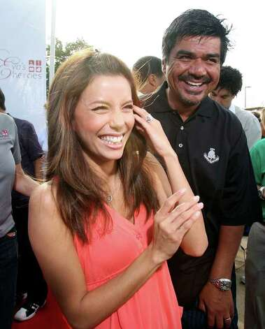 METRO- Comedian and actor George Lopez jokes around with Eva Longoria during the red carpet media at La Cantera Palmer Golf Course during Eva's Hero's Celebrity Golf Tournament Saturday Oct.13,2007. DELCIA LOPEZ/STAFF Photo: DELCIA LOPEZ, SAN ANTONIO EXPRESS NEWS / SAN ANTONIO EXPRESS NEWS