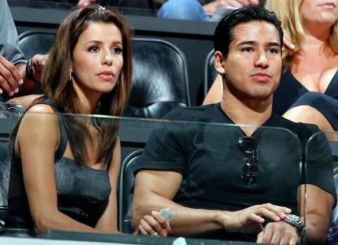 FOR SPORTS - Eva Longoria and Mario Lopez watch the Spurs Panathinaikos game Saturday Oct. 13, 2007 at the AT&T Center. The Spurs won 113-91. (PHOTO BY EDWARD A. ORNELAS) Photo: EDWARD A. ORNELAS, SAN ANTONIO EXPRESS-NEWS / SAN ANTONIO EXPRESS-NEWS