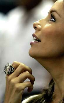 SPORTS    -----   Tony Parker's wife, Eva Longoria, wears Parker's 2007 NBA Championship ring Tuesday night Oct. 30, 2007 at the AT&T Center after a ring ceremony before the start of San Antonio's season-opening game against the Portland Trail Blazers. Photo: WILLIAM LUTHER, SAN ANTONIO EXPRESS-NEWS / SAN ANTONIO EXPRESS-NEWS