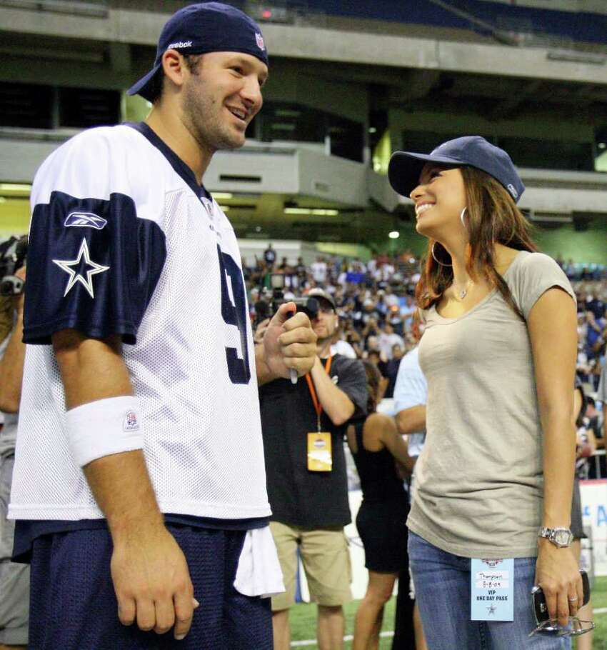 FOR SPORTS - Dallas Cowboys' quarterback Tony Romo (left) talks with Eva Longoria Parker after morning practice Saturday Aug. 8, 2009 at the Alamodome.