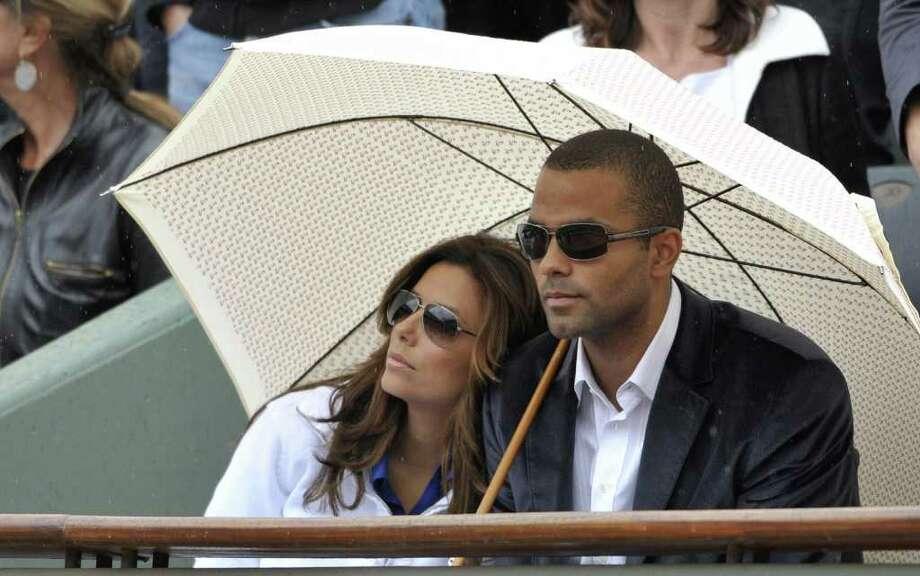 US actress Eva Longoria (L), husband basket-baller Frenchman Tony  Parker watch the French Open tennis men's final match between Swiss Roger Federer and Swedish player Robin Soderling on June 7, 2009 at Roland Garros Stadium in Paris. The event, the second Grand Slam tournament of 2009, runs from May 25 to June 7, 2009.  Fererer won 6/1,7/6,6/4.  AFP PHOTO / BERTRAND GUAY Photo: BERTRAND GUAY, AFP/Getty Images / 2009 AFP