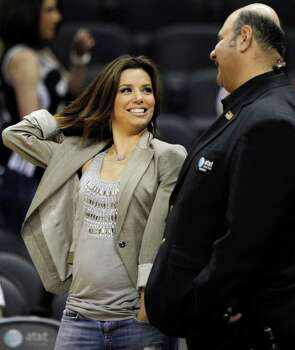 Actress Eva Longoria, left, chats with an AT&T Center employee before an NBA basketball game between the San Antonio Spurs and the Cleveland Cavaliers, Friday, March 26, 2010 in San Antonio. Photo: AP