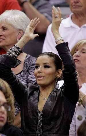 Actress Eva Longoria cheers during Game 4 of a first-round NBA basketball playoff series between the San Antonio Spurs and the Dallas Mavericks, Sunday, April 25, 2010, in San Antonio. Photo: AP