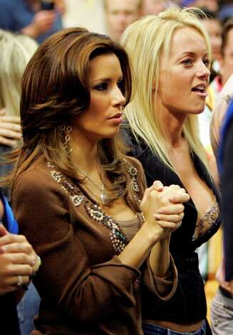 "Eva Longoria of ""Desperate Housewives"" and an unidentified friend watchthe action at the America Airlines Center in Dallas, May 19, 2006, during game six of the NBA Western Conference semifinals playoffs. Jerry Lara/Express-News Photo: Express-News"