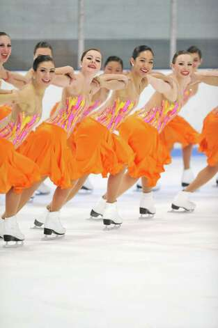 "Here, Skyliner's junior team skates their short program to ""Don't Rain On Our Parade."" From left, second and third girls in the front row are Mairead Brock and Brooke Abbott, both of Cos Cob. Photo: Contributed Photo / Greenwich Citizen"