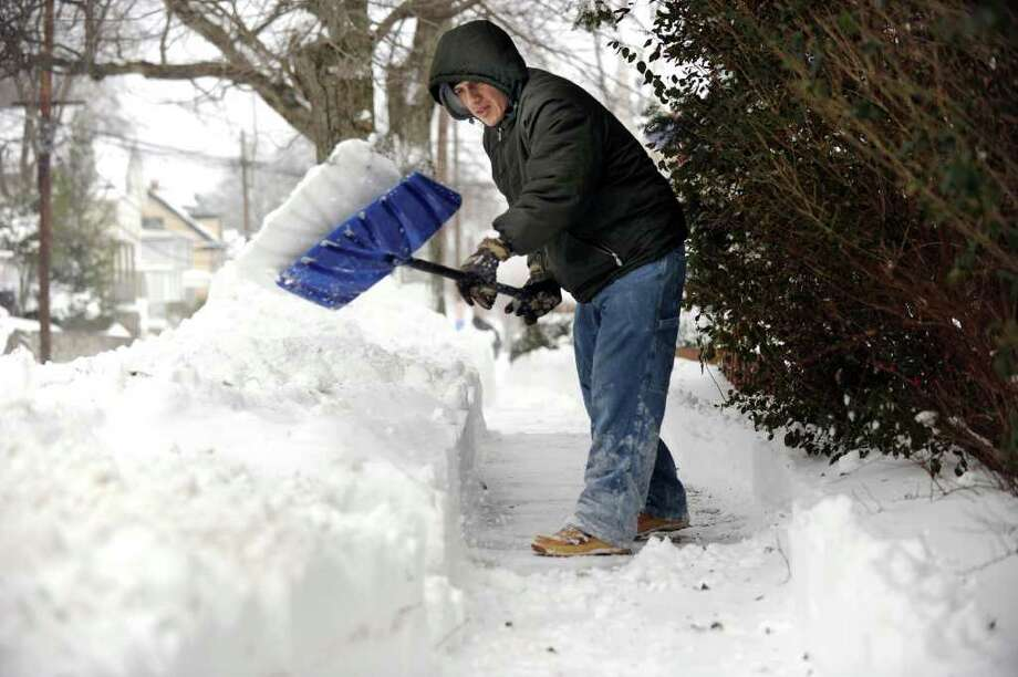 George Ordonez clears the walk in front of his Foster Street home in Danbury Monday, Dec. 27, 2010, after the over-night snow storm. Photo: Carol Kaliff / The News-Times
