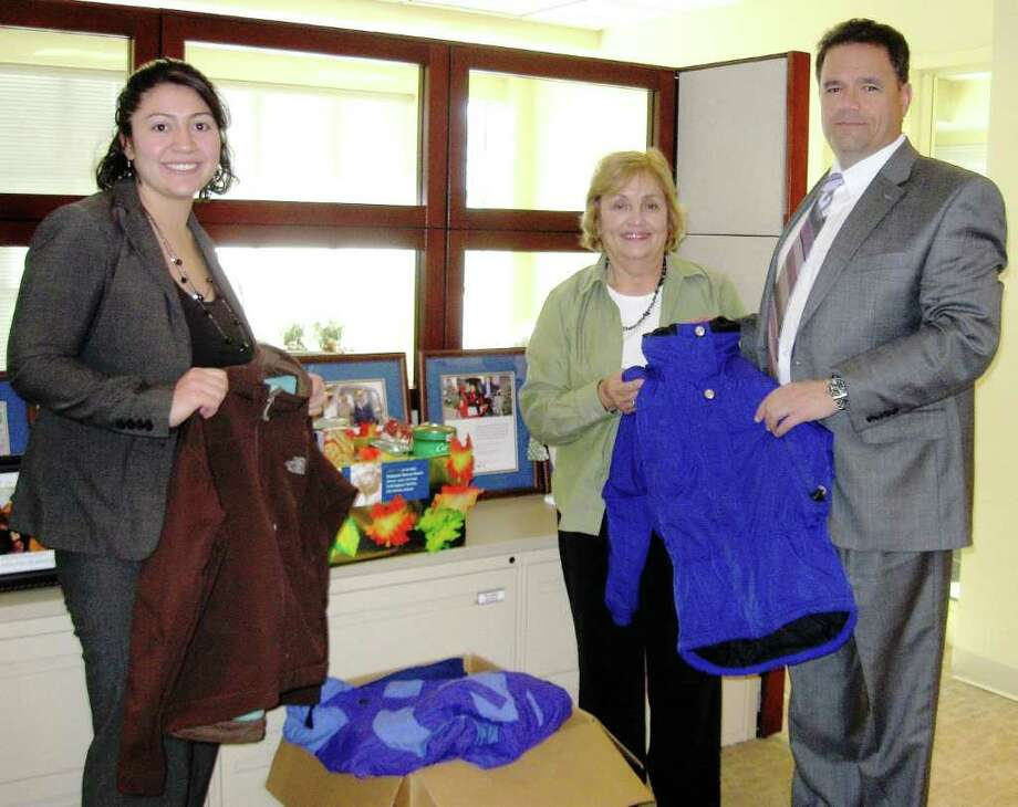 Bank of Fairfield Personal Banker Jessica Shepard (left) and Branch Manager Mark Ahern (right) collect coats and canned goods for the Bridgeport Rescue Mission with Lillian Pesce of Associates in Dermatology. Photo: Contributed Photo / Fairfield Citizen contributed