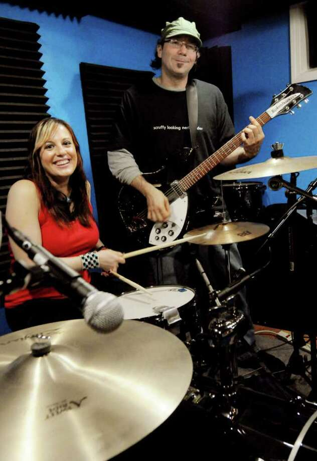 Melanie Krahmer, left, and Rich Libutti form the duo Sirsy, which signed a national record deal in 2010. (Luanne M. Ferris / Times Union) Photo: LMF / 00008902A