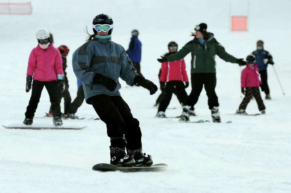 Snowboarders and skiers come down the mountain on Tuesday at Jiminy Peak in Hancock, Mass. (Cindy Schultz / Times Union)