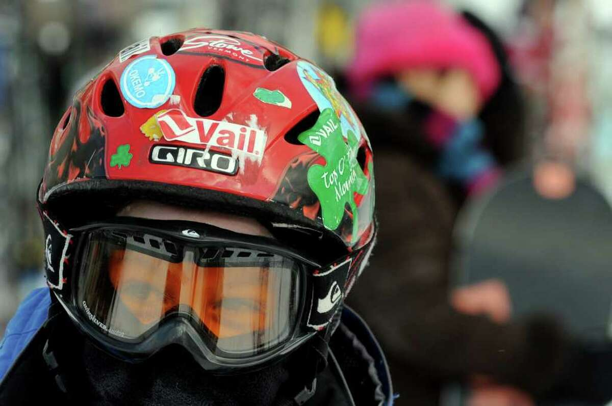 Matthew Russell of Greenwich, Conn.wears his helmet decorated with stickers from ski resorts on Tuesday at Jiminy Peak in Hancock, Mass. About 4,600 visited the resort Tuesday. (Cindy Schultz / Times Union)