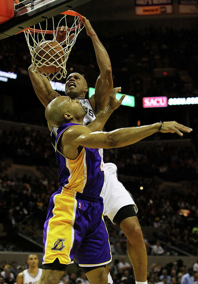 Spurs' Richard Jefferson (24) dunks over Los Angeles Lakers' Derek Fisher (02) in the first half at the AT&T Center on Tuesday, Dec. 28, 2010.  Kin Man Hui/kmhui@express-news.net Photo: KIN MAN HUI, SAN ANTONIO EXPRESS-NEWS / kmhui@express-news.net