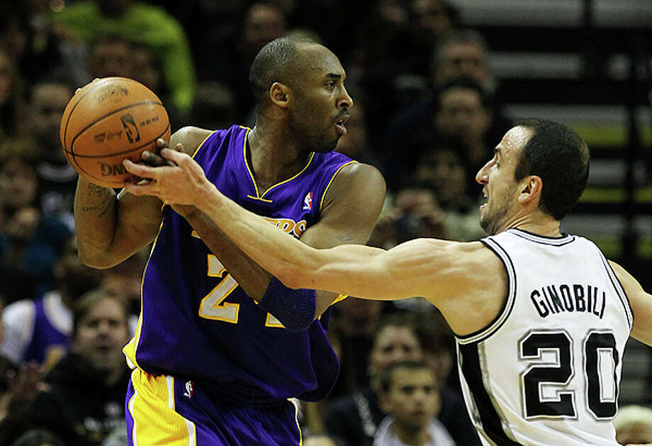 Spurs' Manu Ginobili (20) attempts a steal against the Los Angeles Lakers' Kobe Bryant (24) in the first half at the AT&T Center on Tuesday, Dec. 28, 2010.  Kin Man Hui/kmhui@express-news.net Photo: KIN MAN HUI, SAN ANTONIO EXPRESS-NEWS / kmhui@express-news.net