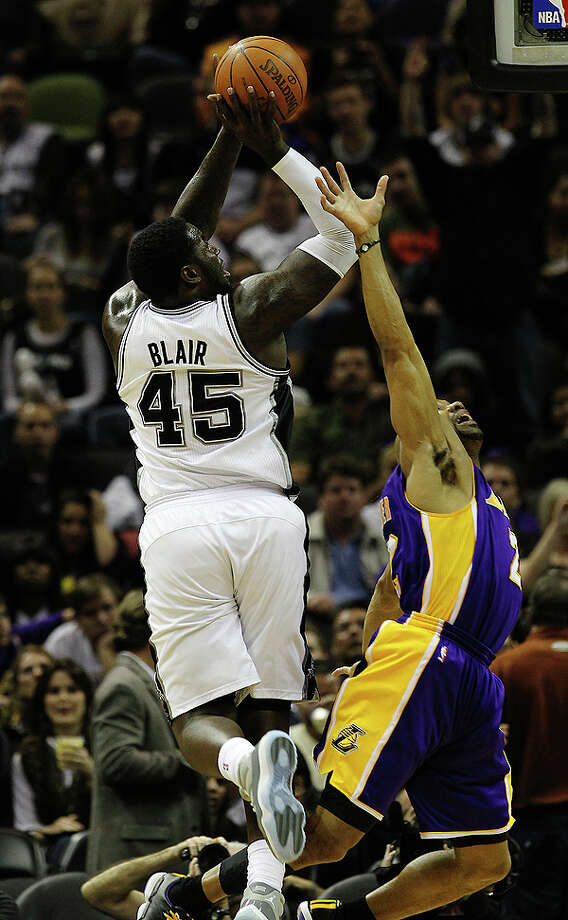 Spurs' DeJuan Blair (45) shoots over Los Angeles Lakers' Derek Fisher (02) in the second half at the AT&T Center on Tuesday, Dec. 28, 2010.  Spurs defeated the Lakers 97-82. Kin Man Hui/kmhui@express-news.net Photo: KIN MAN HUI, SAN ANTONIO EXPRESS-NEWS / kmhui@express-news.net