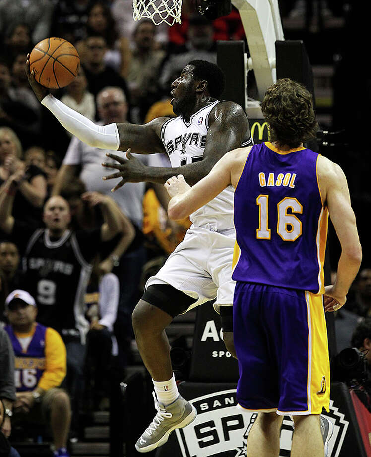 Spurs' DeJuan Blair (45) drives past Los Angeles Lakers' Pau Gasol (16) to score in the second half at the AT&T Center on Tuesday, Dec. 28, 2010.  Spurs defeated the Lakers 97-82. Kin Man Hui/kmhui@express-news.net Photo: KIN MAN HUI, SAN ANTONIO EXPRESS-NEWS / kmhui@express-news.net