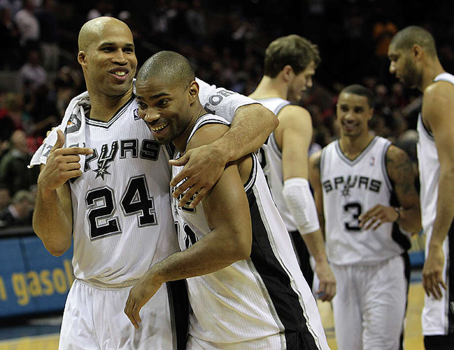 Spurs' Richard Jefferson (left) and Gary Neal (14) celebrate the victory against the Los Angeles Lakers at the end of the game at the AT&T Center on Tuesday, Dec. 28, 2010.  Spurs defeated the Lakers 97-82. Kin Man Hui/kmhui@express-news.net Photo: KIN MAN HUI, SAN ANTONIO EXPRESS-NEWS / kmhui@express-news.net