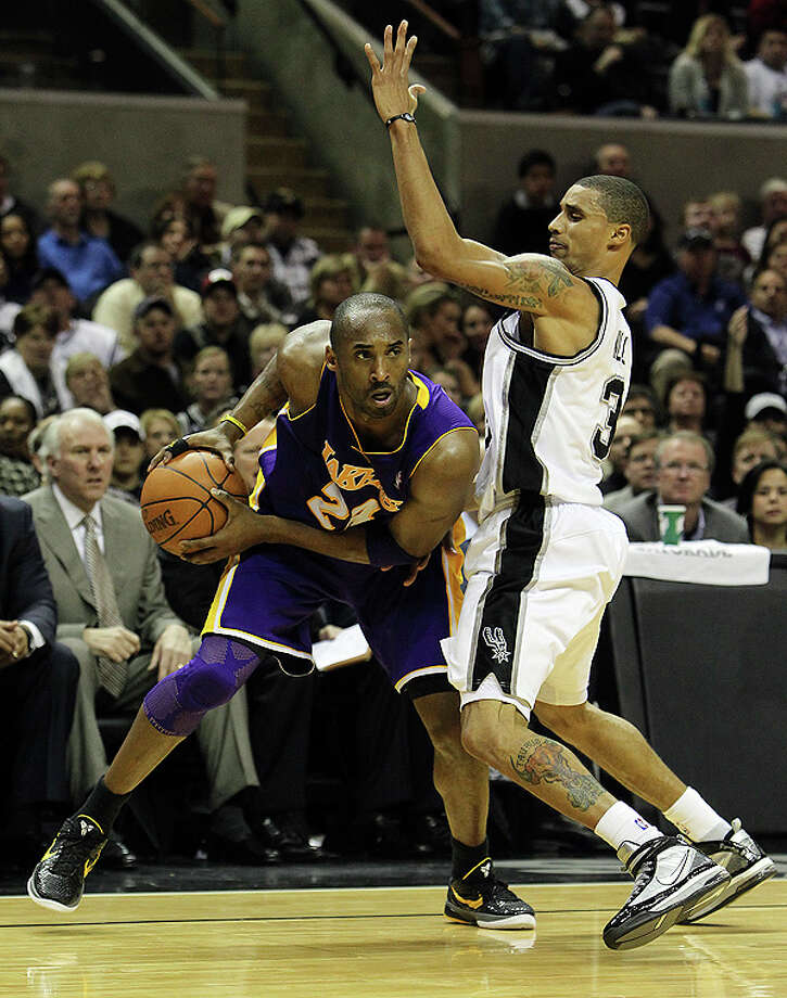 Spurs' George Hill (right) covers Los Angeles Lakers' Kobe Bryant (24) in the second half at the AT&T Center on Tuesday, Dec. 28, 2010.  Spurs defeated the Lakers 97-82. Kin Man Hui/kmhui@express-news.net Photo: KIN MAN HUI, SAN ANTONIO EXPRESS-NEWS / kmhui@express-news.net