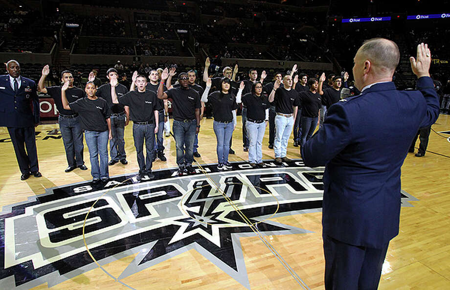 Air Force Col. Tim Swinney swears in a batch of recruits pregame as fans attend the Spurs-Lakers game at the AT&T Center in San Antonio on December 28, 2010. Tom Reel/Staff Photo: TOM REEL, SAN ANTONIO EXPRESS-NEWS / © 2010 San Antonio Express-News
