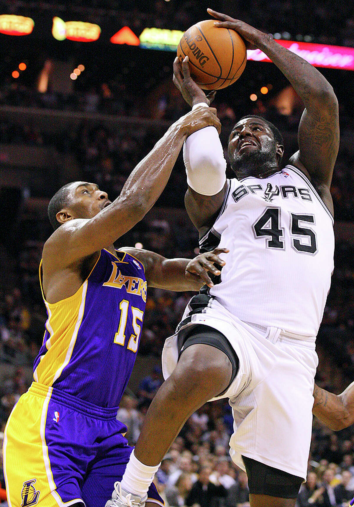 Spurs' DeJuan Blair is fouled by Lakers' Ron Artest during second half action Tuesday Dec. 28, 2010 at the AT&T Center. The Spurs won 97-82. EDWARD A. ORNELAS/eaornelas@express-news.net