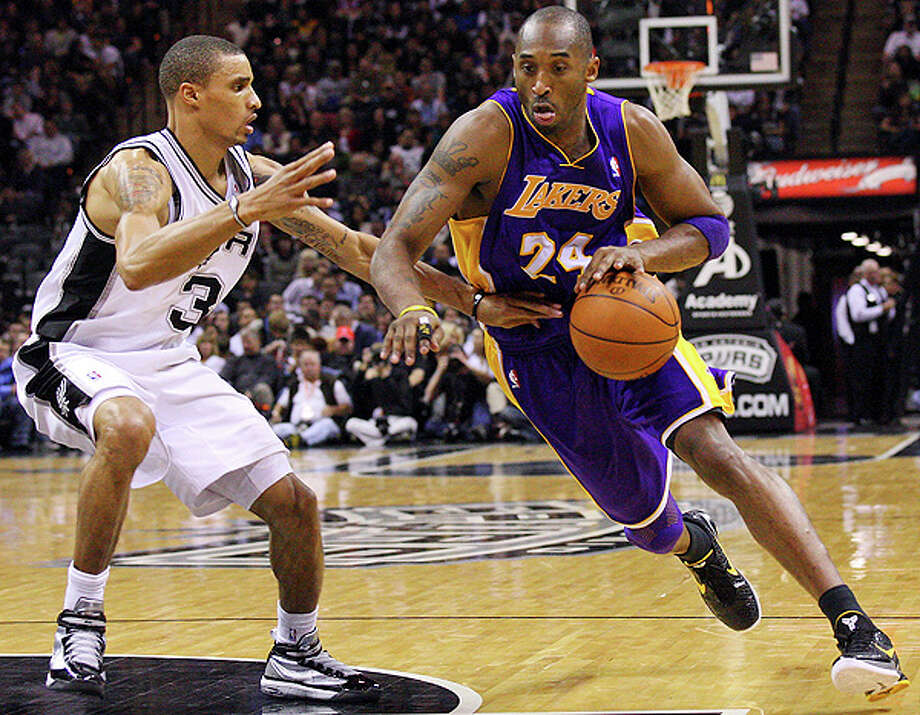 Spurs' George Hill defends  Lakers' Kobe Bryant during first half action Tuesday Dec. 28, 2010 at the AT&T Center.  EDWARD A. ORNELAS/eaornelas@express-news.net Photo: EDWARD A. ORNELAS, SAN ANTONIO EXPRESS-NEWS / eaornelas@express-news.net