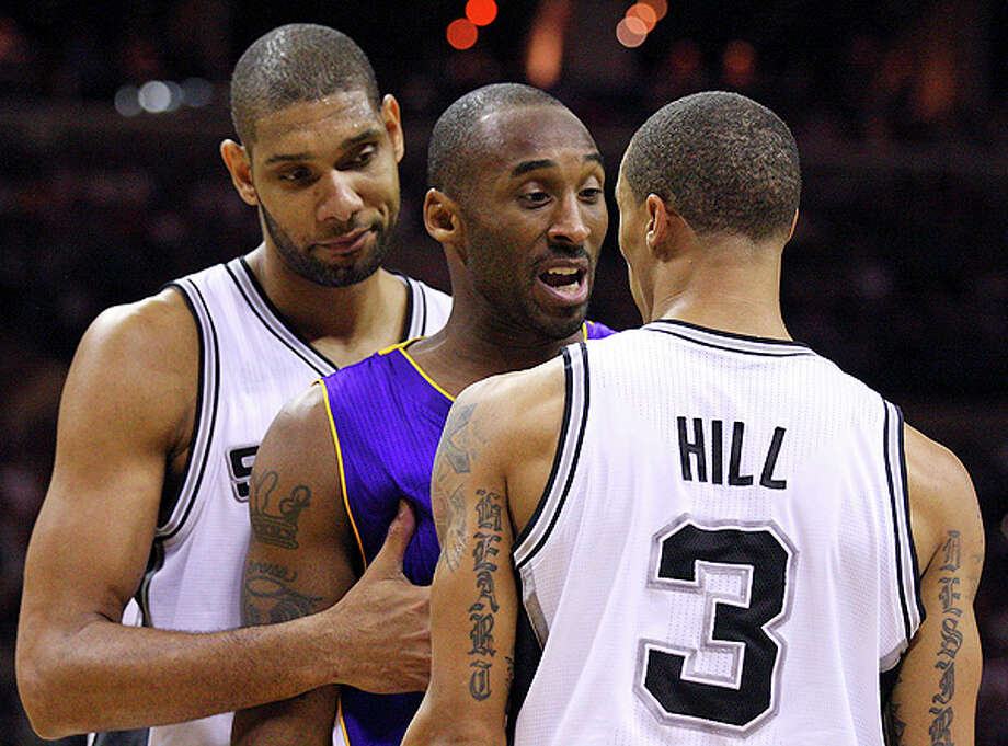 Spurs' Tim Duncan holds back Lakers' Kobe Bryant as he and Spurs' George Hill exchange words during first half action Tuesday Dec. 28, 2010 at the AT&T Center.  EDWARD A. ORNELAS/eaornelas@express-news.net Photo: EDWARD A. ORNELAS, SAN ANTONIO EXPRESS-NEWS / eaornelas@express-news.net