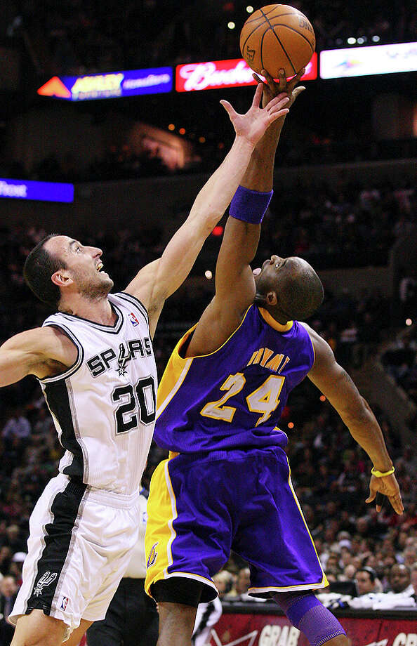 Spurs' Manu Ginobili and  Lakers' Kobe Bryant grab for the ball during first half action Tuesday Dec. 28, 2010 at the AT&T Center. EDWARD A. ORNELAS/eaornelas@express-news.net Photo: EDWARD A. ORNELAS, SAN ANTONIO EXPRESS-NEWS / eaornelas@express-news.net